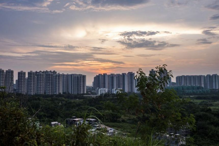 In a photo taken on Sept 9, 2019, residential buildings stand at dusk in the Tin Shui Wai district of Hong Kong.