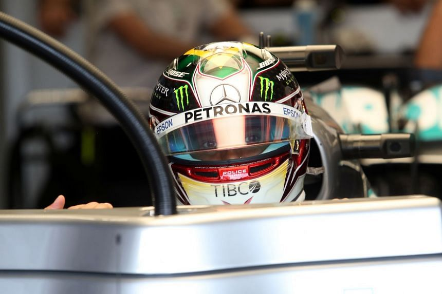 Mercedes' Lewis Hamilton in the pits during practice.