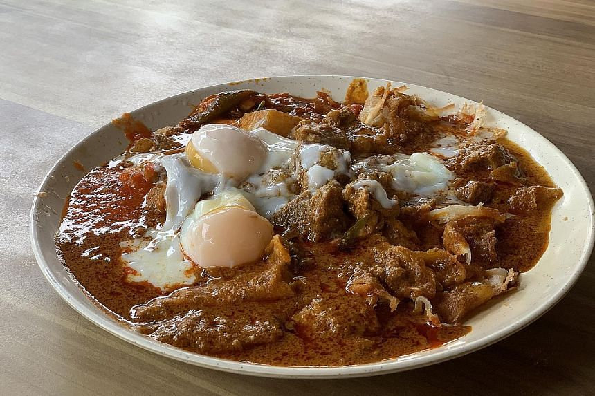 The R.K. Special comes with two pieces of crispy plain prata drenched in mutton curry and topped with two wobbly soft-boiled eggs.
