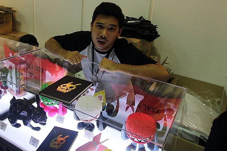 Mr Aw at the Mighty Jaxx booth at the Singapore Comic Convention in 2015. From a humble start, he now employs 45 staff and has a new, funkily furnished 6,500 sq ft office in Tai Seng industrial estate. Mr Jackson Aw, 30, started his collectible toy b