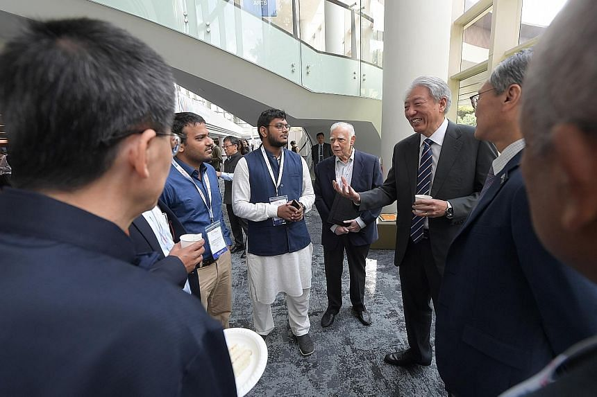 Senior Minister Teo Chee Hean interacting with some guests at the fourth South Asian Diaspora Convention held at the National University of Singapore's University Cultural Centre yesterday.
