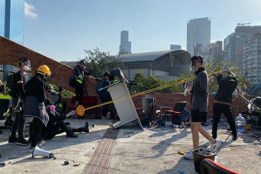 Protesters practising with a giant catapult from the roof of the Hong Kong Polytechnic University during a stand-off with the police, on Nov 17, 2019.
