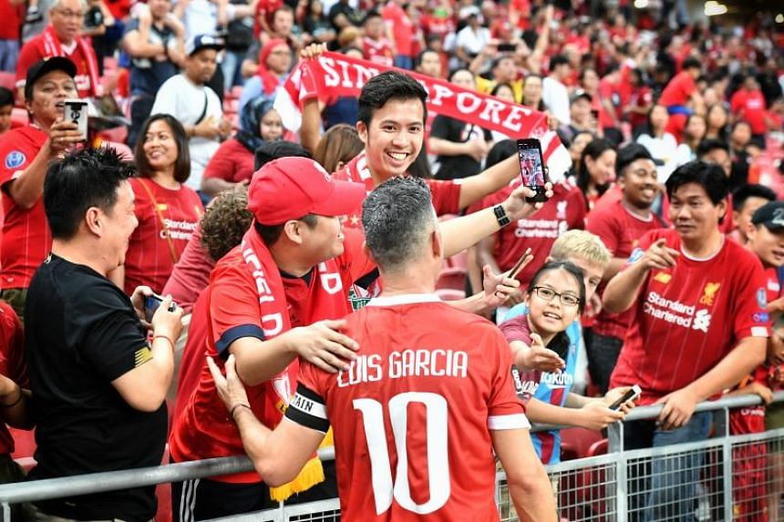 Liverpool Reds' Luis Garcia meets fans after the Battle of the Reds match between Liverpool Reds and Manchester Reds at the National Stadium on Nov 16, 2019.
