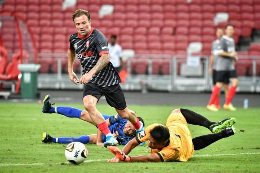 Manchester Reds' Michael Gray scores during the Battle of the Reds match against Singapore Reds at the National Stadium on Nov 16, 2019.