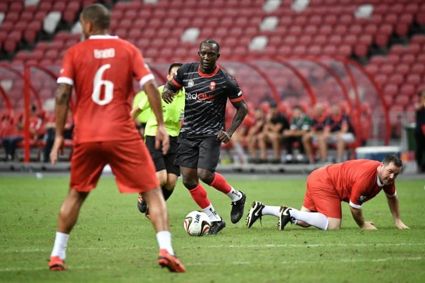 Manchester Reds' Dwight Yorke in action during the Battle of the Reds match against Liverpool Reds at the National Stadium on Nov 16, 2019.