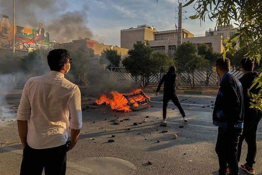Iranian protesters block a road during a demonstration against an increase in gasoline prices in the central city of Shiraz.