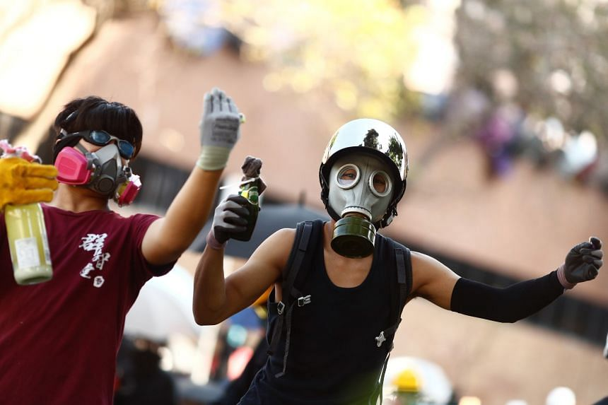Protesters wear gas masks during clashes with police outside Hong Kong Polytechnic University in Hong Kong on Nov 17, 2019.