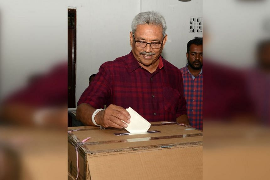Sri Lanka's former Defence Secretary and presidential candidate Gotabaya Rajapaksa casts his vote at a polling station in Colombo, Sri Lanka, on Nov 16, 2019.