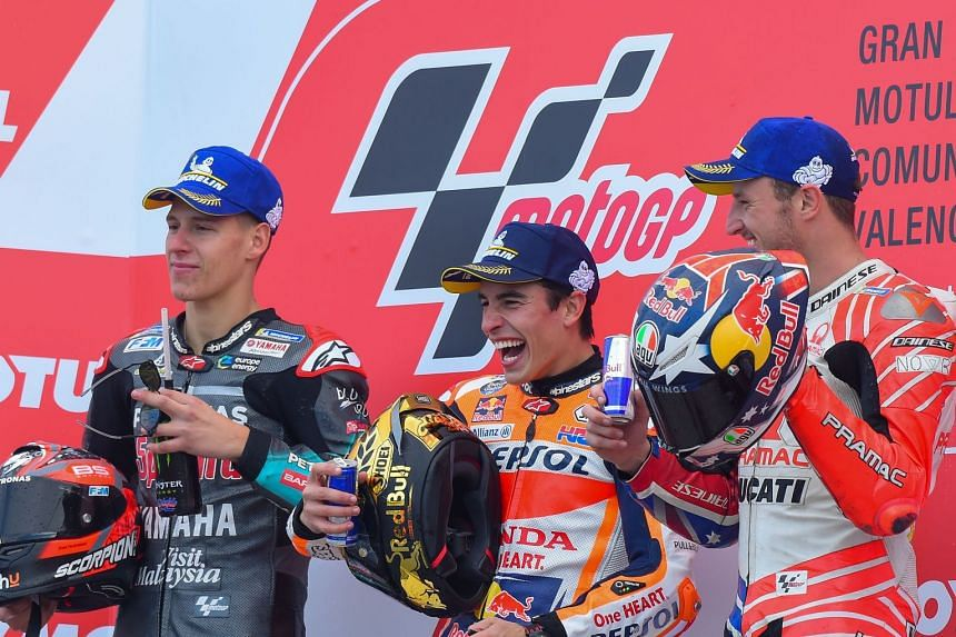 Winner Spanish rider Marc Marquez, second-placed Frenchman Fabio Quartararo (left) and third-placed Australian Jack Miller celebrating on the podium after the MotoGP Valencia Grand Prix on Nov 17, 2019.