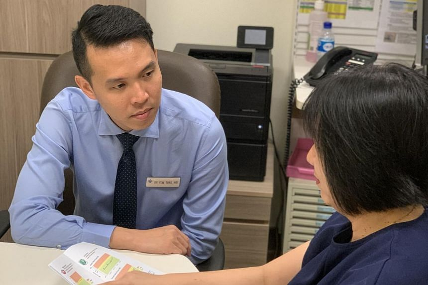 National University Hospital endocrinologist Dr Yew Tong Wei in an appointment with his patient, Madam Evelyn Yeung, to discuss her diabetes condition. She had received a results letter before the consultation appointment, which gave her time to mull