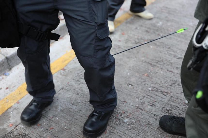 A Hong Kong police officer was hit in the leg by an arrow during a stand-off outside the Hong Kong Polytechnic University on Nov 17, 2019.