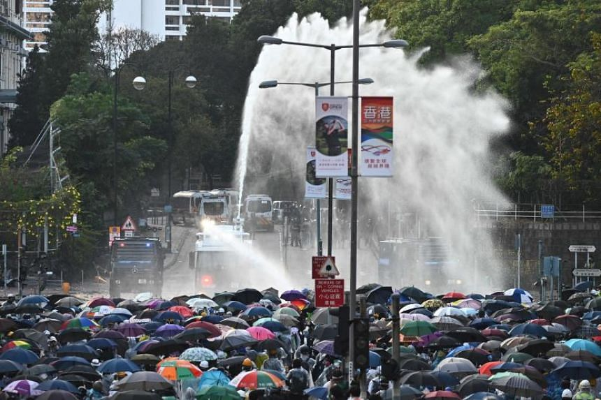 Hong Kong police using water cannon to disperse protesters outside Hong Kong Polytechnic University on Nov 17, 2019.