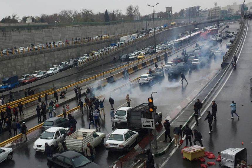 People protesting against increased petrol prices on a highway in Teheran on Nov 16, 2019.