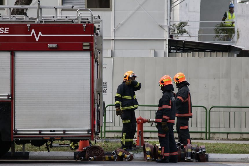 SCDF officers preparing equipment before the disposal of the WWII bomb.