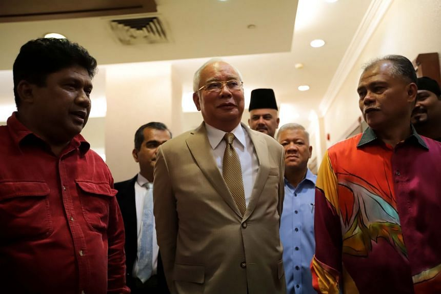 Malaysia's former prime minister Najib Razak (centre) arrives for his trial at the High Court in Kuala Lumpur on Nov 18, 2019.