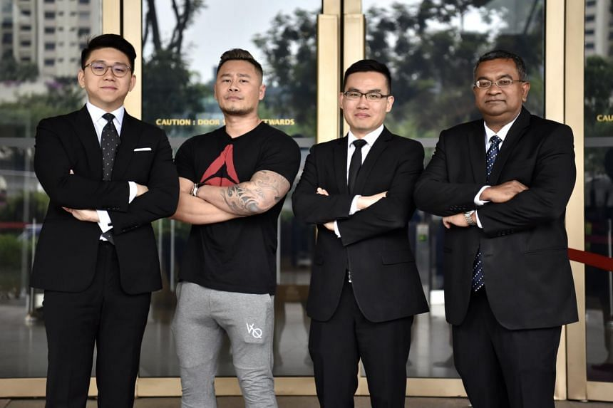 Mr Johnson Ong Ming (in T-shirt) with his lawyers, (from left) Mr Johannes Hadi, Mr Suang Wijaya and Mr Eugene Thuraisingam.