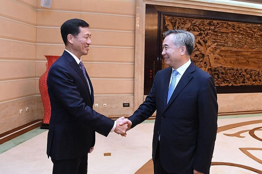 Education Minister Ong Ye Kung with Guangdong party boss Li Xi in Guangzhou yesterday. At an annual council meeting, Mr Ong spoke of how Singapore and Guangdong complement each other.