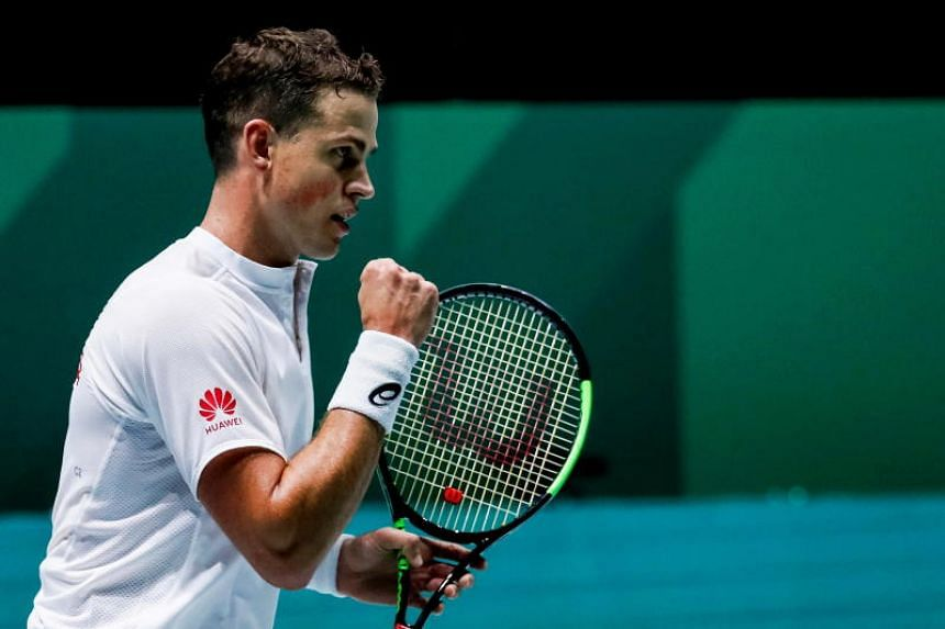 Canada's Vasek Pospisil reacting after winning a point against Italy's Fabio Fognini in the Group F tie of the Davis Cup Finals tennis tournament in Madrid, Spain, on Nov 18, 2019.