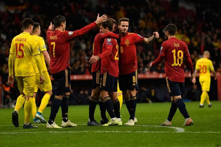 Spain's forward Iquel Oyarzabal (centre) is congratulated by teammates after scoring a goal during the Euro 2020 Group F qualification football match between Spain and Romania at the Wanda Metropolitano Stadium in Madrid on Nov 18, 2019.
