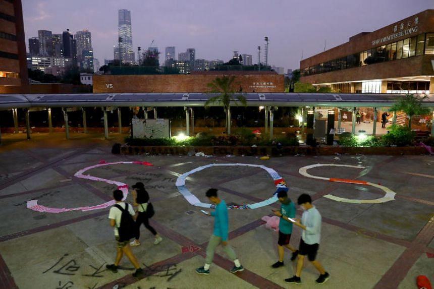 """An """"SOS"""" sign, made using clothes, on the campus of the Hong Kong Polytechnic University on Nov 19, 2019."""