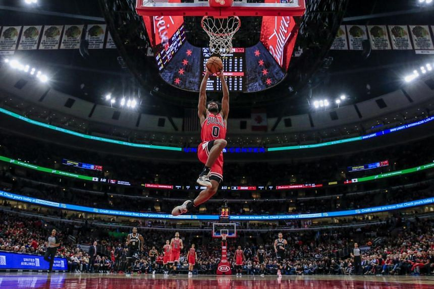 Chicago Bulls guard Coby White (centre) scores during the NBA game between the Brooklyn Nets and the Chicago Bulls, on Nov 16, 2019.