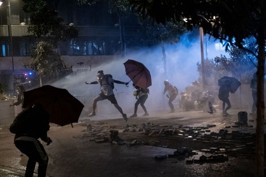 Protesters clash with police near Hong Kong Polytechnic University, on Nov 19, 2019.