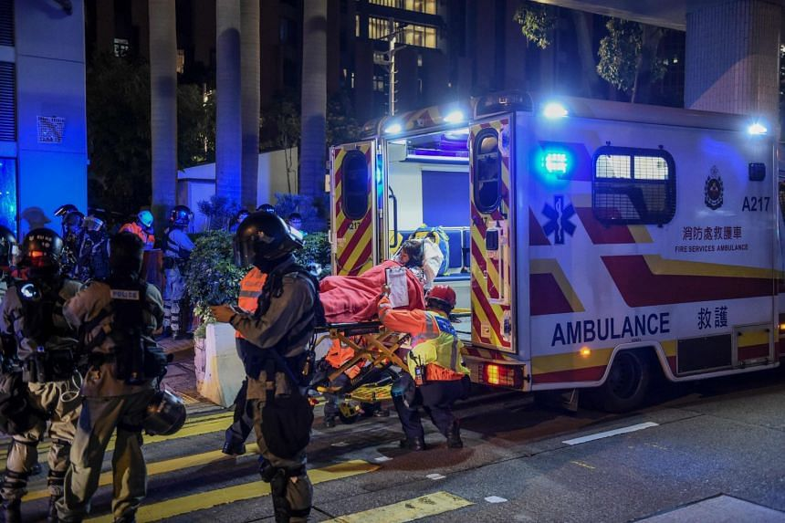 A student being lifted onto an ambulance after the clashes between protesters and riot police at the Hong Kong Polytechnic University campus, on Nov 18, 2019.