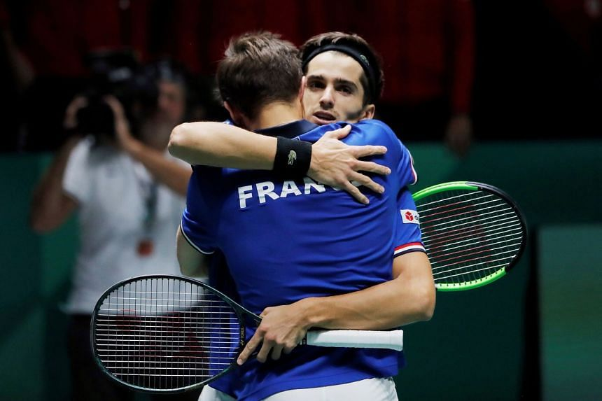 France's Nicolas Mahut and Pierre-Hugues Herbert celebrate after winning their doubles match.