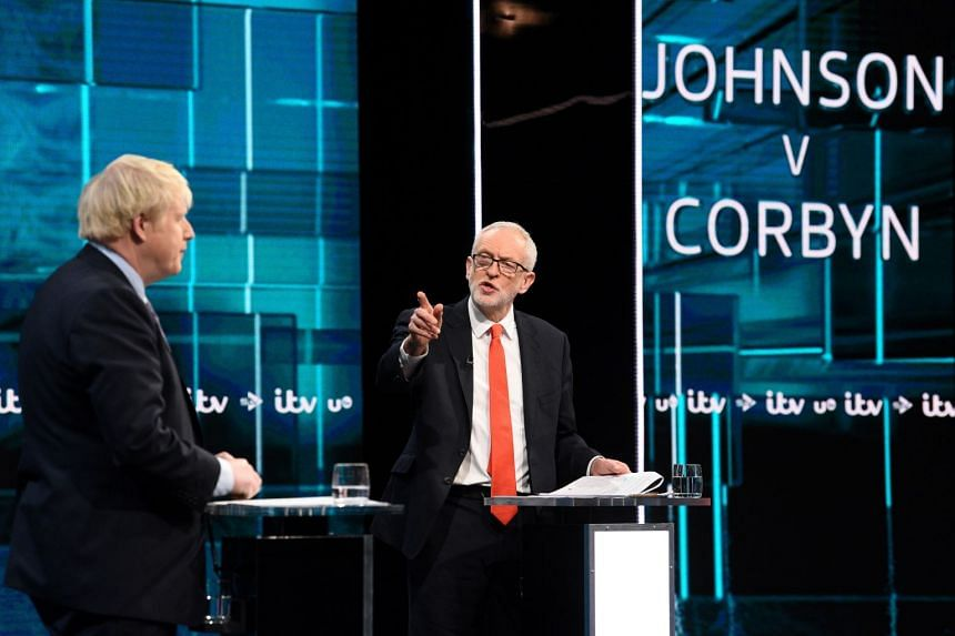Conservative leader Boris Johnson (left) and Labour leader Jeremy Corbyn are seen during a televised debate ahead of Britain's general election.