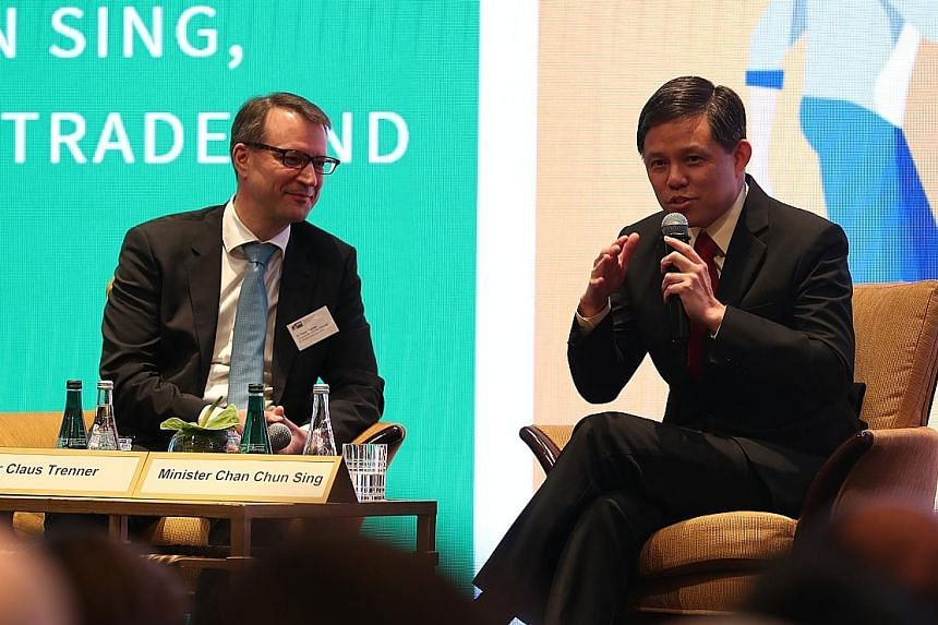 Singaporean-German Chamber of Industry and Commerce president Claus Trenner with Trade and Industry Minister Chan Chun Sing at a dialogue session at the Conrad Centennial Singapore yesterday.