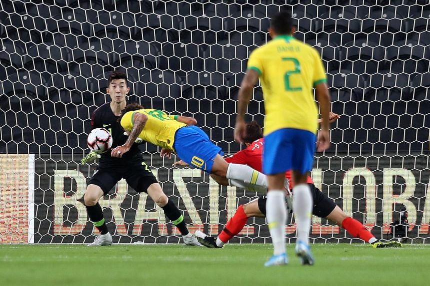 `Brazil's Lucas Paqueta stooping to head in the opening goal against South Korea, whose goalkeeper Jo Hyeon-woo could do little to prevent the goal. Brazil won 3-0 at the Mohammed bin Zayed Stadium in Abu Dhabi. PHOTO: REUTERS