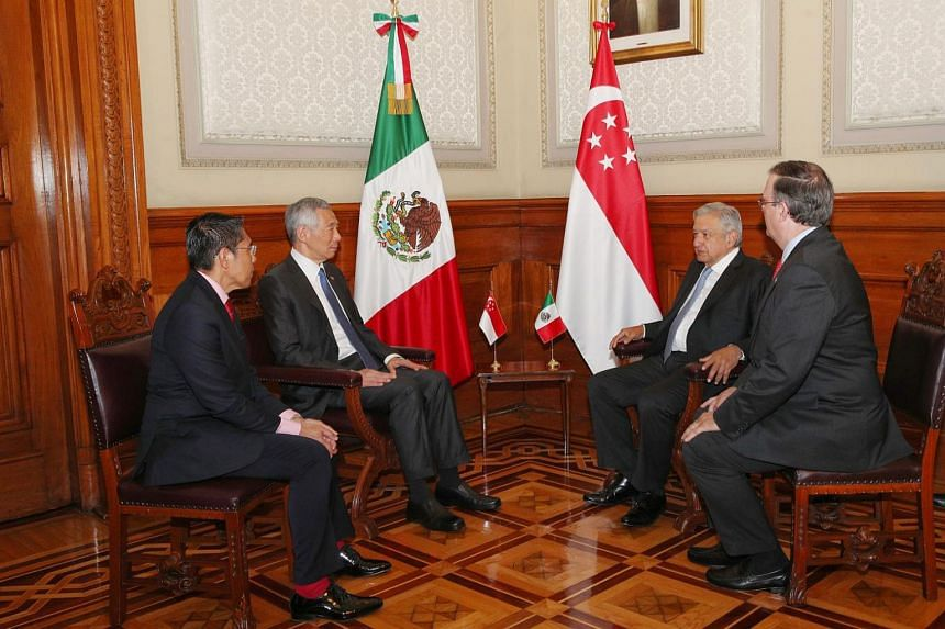 PM Lee Hsien Loong and Senior Minister of State for Defence and Foreign Affairs Maliki Osman (left) in a meeting with Mexican President Andres Manuel Lopez Obrador (second from right).