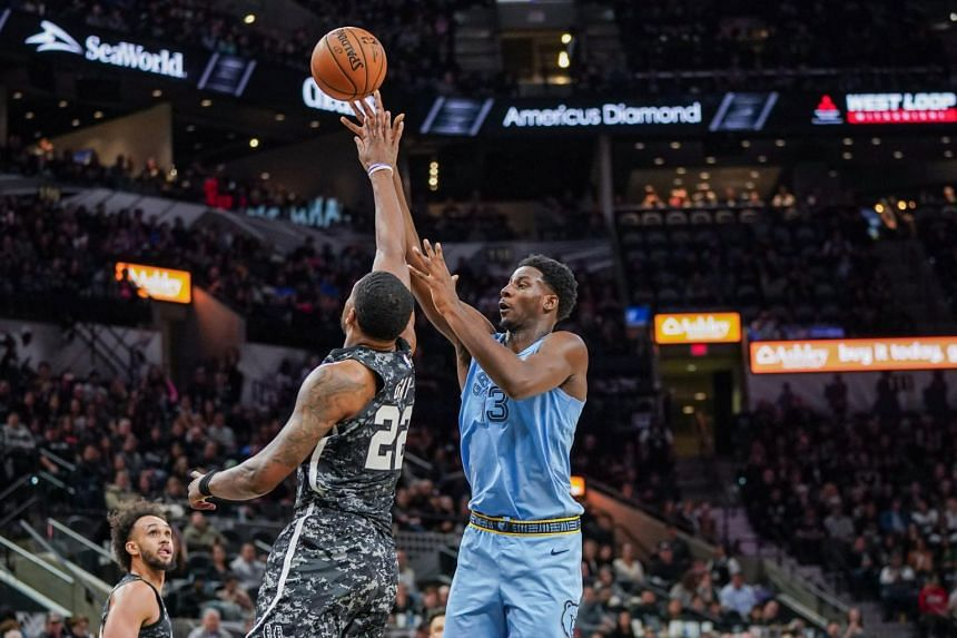 Memphis Grizzlies guard Grayson Allen (3) shoots over San Antonio Spurs forward Rudy Gay (22) in the second half at the AT&T Center.