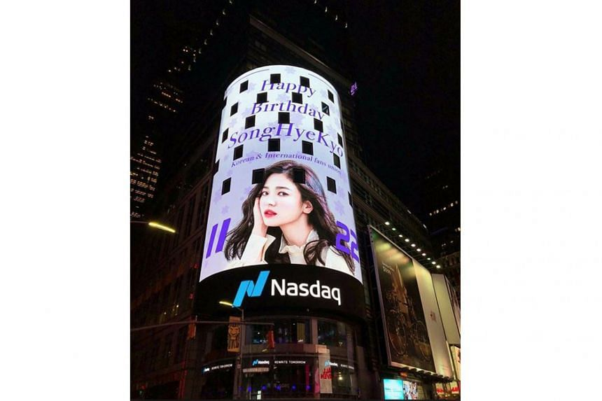 Song Hye-kyo's face lighting up a giant billboard (above) in Times Square after fans of the South Korean actress paid for the use of the space to celebrate her 38th birthday on Friday.