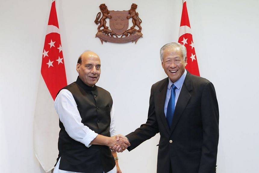 Defence Minister Ng Eng Hen and Indian Defence Minister Rajnath Singh shake hands with each other at Mindef HQ on Nov 20, 2019.