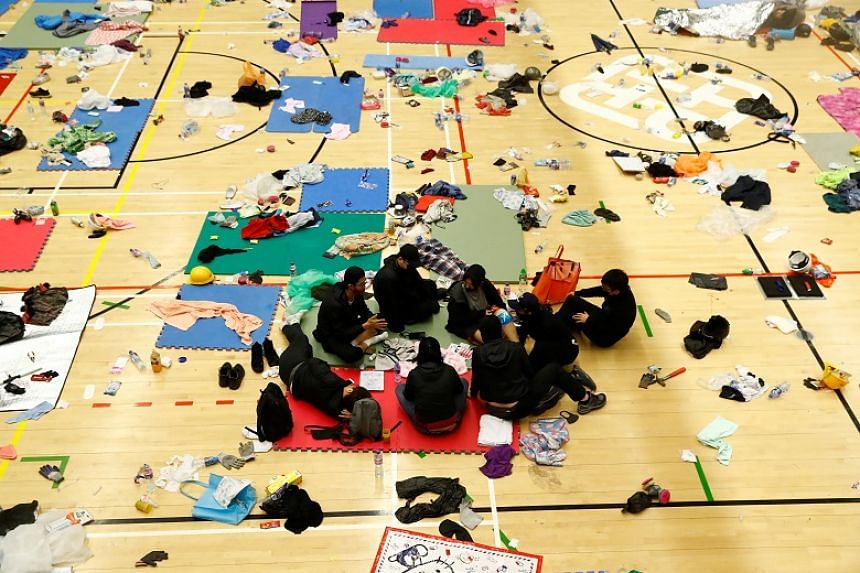 Anti-government protesters rest in the gymnasium at the besieged Hong Kong Polytechnic University in Hong Kong on Nov 20, 2019.