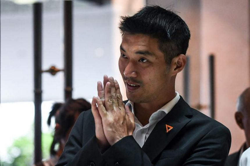 In a photo taken on March 27, Future Forward Party leader Thanathorn Juangroongruangkit arrives at a hotel for a joint press conference with other political party leaders in Bangkok.
