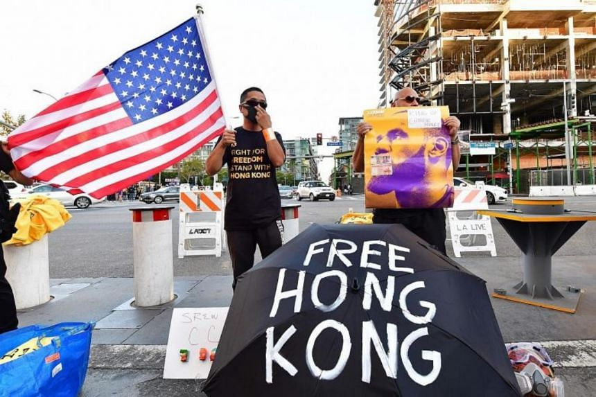 Supporters of Hong Kong's pro-democracy movement rally outside the Los Angeles' Staples Centre in Oct 2019.