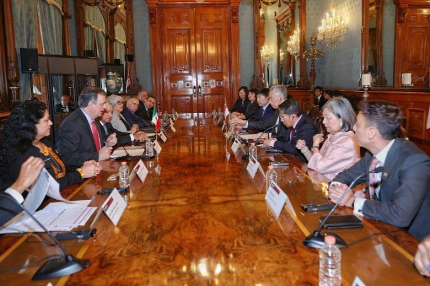 Delegates from Singapore, including PM Lee Hsien Loong and Senior Minister of State for Defence and Foreign Affairs Maliki Osman, in a meeting with officials in Mexico.