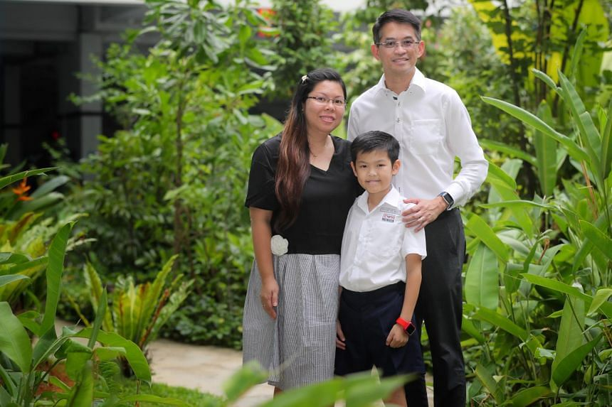 Ai Tong School pupil Gerome Tay alongside parents Kelvin Tay, 45, and Sylvia Tay, 39, after receiving his PSLE results on Nov 21, 2019.