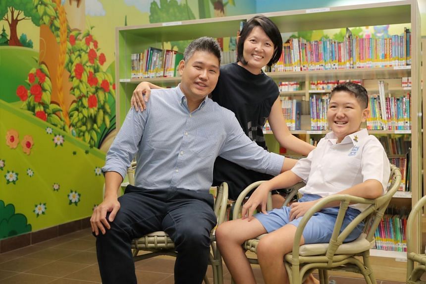Tao Nan School pupil Lim Rui Ze, 12, with his parents Lim Wei Hong and Shereen Wong, both 41, at the school before receiving his PSLE results on Nov 21, 2019.