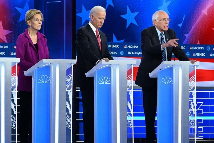 Senator Elizabeth Warren, former vice-president Joe Biden and Senator Bernie Sanders at the fifth Democratic debate of the 2020 election season in Atlanta, Georgia, on Nov 20, 2019.