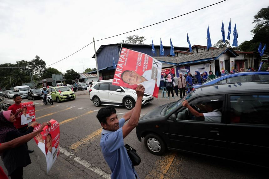 Pakatan Harapan and Barisan Nasional supporters near a polling centre in Tanjung Piai in Johor on Nov 16, 2019.