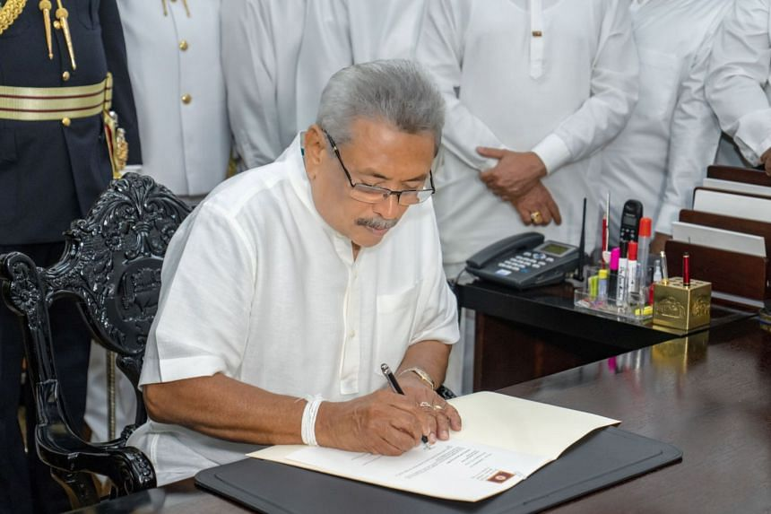 A handout photo made available by the President Media unit shows Sri Lanka's new President Gotabaya Rajapaksa assuming his duties at the Presidential Secretariat in Colombo, Sri Lanka, on Nov 19, 2019.