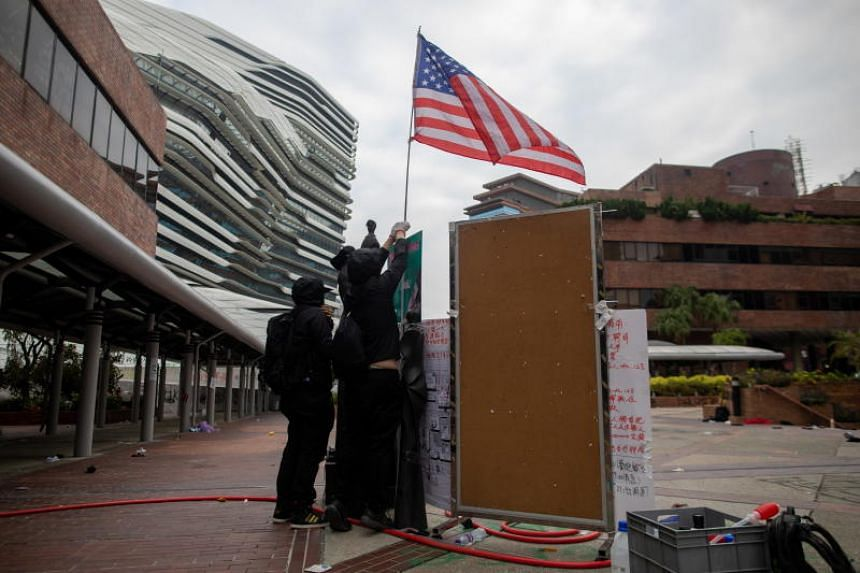 Protesters display a US flag inside Polytechnic University of Hong Kong on Nov 20, 2019.