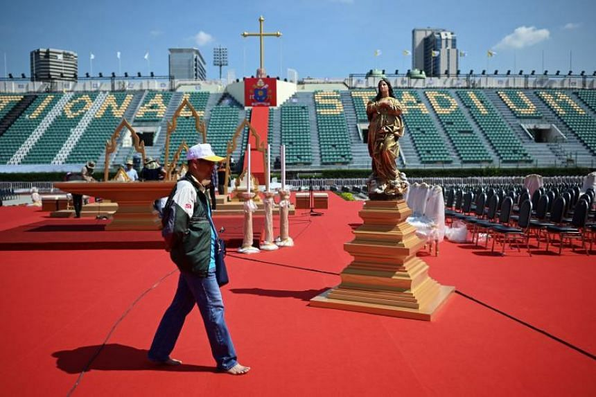 An official walks on the main stage where Pope Francis is scheduled to conduct holy mass at the National Stadium in Bangkok on Nov 20, 2019.