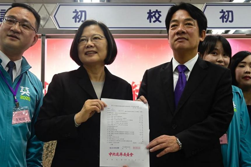 Taiwanese President Tsai Ing-wen and former premier William Lai display a certificate after registering as presidential and vice-presidential election candidates in Taipei on Nov 19, 2019.