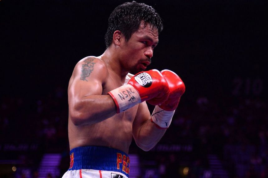 Pacquiao (above) revealed a four-week-old injury three hours before the fight started.