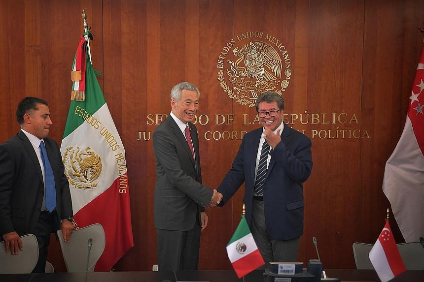 Prime Minister Lee Hsien Loong being presented with the Distinguished Guest of the City and Mayor Medal by Mexico City Mayor Claudia Sheinbaum at the City Hall in Mexico City on Wednesday. PM Lee meeting Senator Ricardo Monreal Avila, president of th