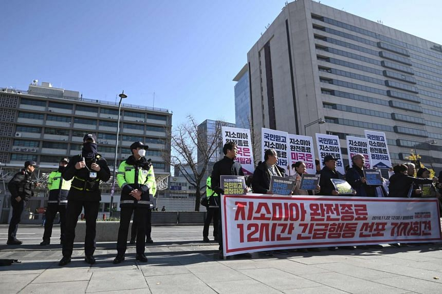 South Korean protesters hold placards during a rally demanding an end to the GSOMIA between South Korea and Japan, in front of the US embassy in Seoul on Nov 22, 2019.